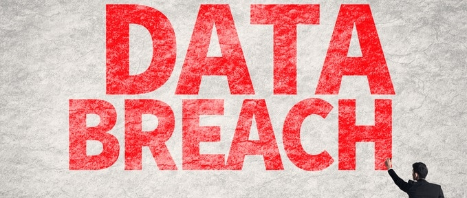 Asian business man write words on wall, Data Breach