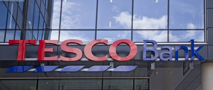 Glasgow, Scotland, UK - 6th May, 2011: A sign above the entrance of a purpose built Tesco Bank centre. Tesco Bank is a rebranding of Tesco Personal Finance, owned by the UK's largest supermarket chain. It is an internet and telephone bank.
